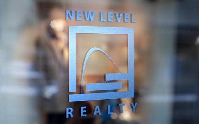 New Level Realty logo on window